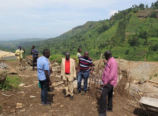 Permanent Secretary, Bulegeni Town Council Mayor,  WSDF-East Manager and his team inspecting progress of work of Bulegeni WSSS.